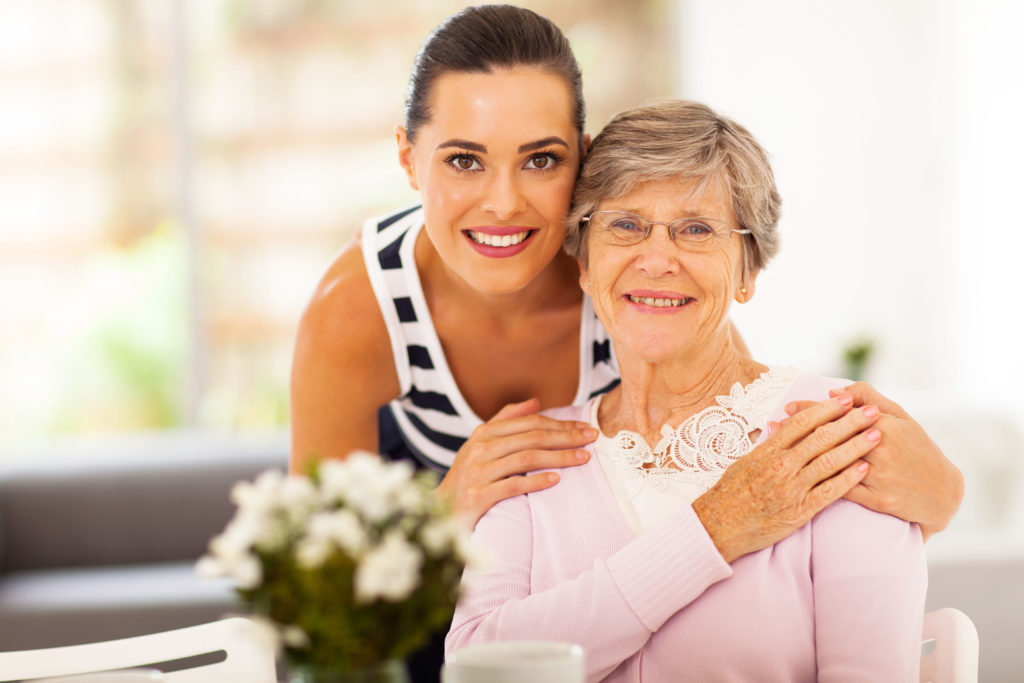 caring home health aide with a patient