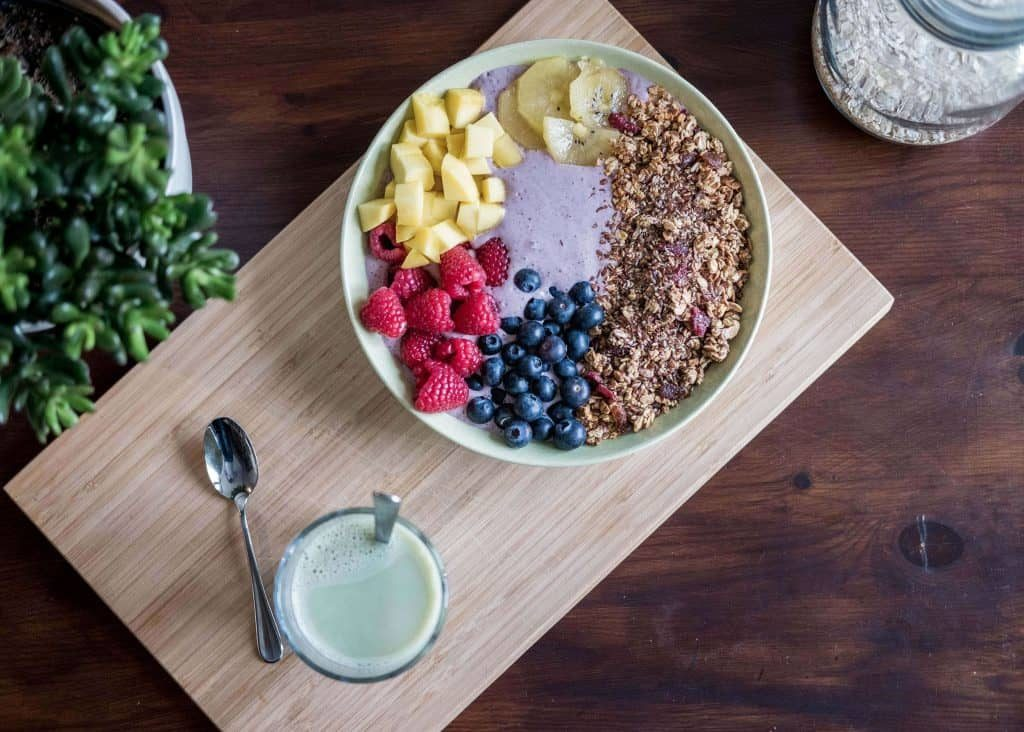 a bowl with oatmeals and fruits the best way to prevent vitamins deficiency